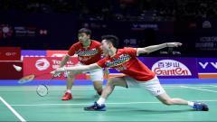 Indosport - Aksi Kevin Sanjaya/Marcus Gideon di China Open 2019.
