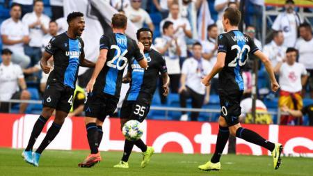 Pemain Club Brugge, Emmanuel Denis, merayakan golnya ke gawang Real Madrid di Santiago Bernabeu. - INDOSPORT