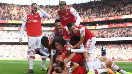 Aksi selebrasi pemain Arsenal usai David Luiz mencetak gol. - INDOSPORT