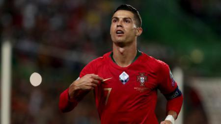 Cristiano Ronaldo saat merayakan gol ke gawang Luksemburg. - INDOSPORT