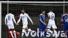 Indosport - Olivier Giroud saat merayakan gol di pertandingan Kualifikasi Euro 2020 antara Islandia vs Prancis pada Sabtu (12/10/19) dini hari WIB.