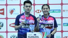 Indosport - Ganda campuran Leo Rolly Carnando dan Indah Cahya Sari Jamil runner up Kejuaraan Dunia Junior Bulutangkis 2019.