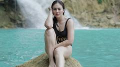 Indosport - Wulan Guritno berpose cantik pasca berenang