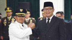 Indosport - Bupati Indramayu Supendi saat dilantik Ridwan Kamil