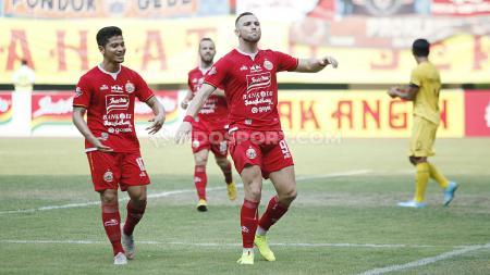 Selebrasi pemain Persija Jakarta, Marko Simic usai mencetak gol ke gawang Semen Padang pada Liga 1 di Stadion Patriot Bekasi, Rabu (16/10/19). - INDOSPORT
