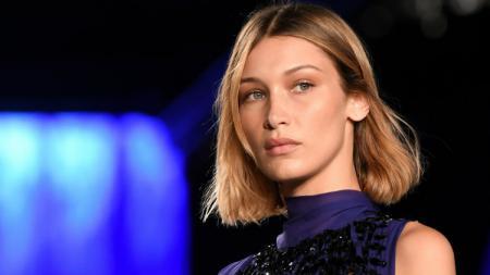 Model Bella Hadid pernah ketahuan berdekatan dengan David Beckham. - INDOSPORT