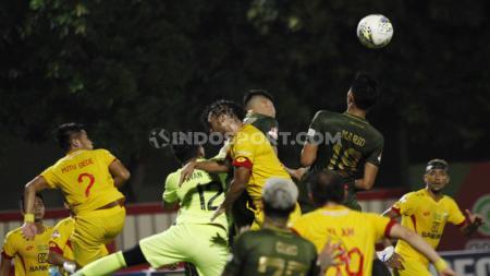 Bek Bhayangkara FC, I Putu Gede Juni Antara menyatakan tidak terpengaruh dengan hasil buruk yang dialaminya saat bergabung dengan Timnas Indonesia belum lama ini. - INDOSPORT