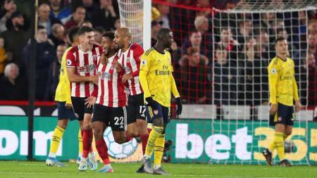 Lys Mousset merayakan gol pada laga Sheffield United vs Arsenal di Liga Inggris (Premier League) 2019/2020, Selasa (22/10/19). - INDOSPORT