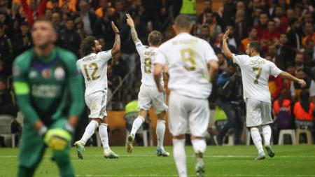 Selebrasi pemain Real Madrid setelah Toni Kroos sukses mencetak gol ke gawang Galatasaray pada laga lanjutan Liga Champions, Rabu (23/10/19) dini hari WIB. - INDOSPORT