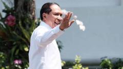 Indosport - Calon kuat Menpora, Zainudin Amali saat datang ke Istana Negara, Selasa (22/10/19).