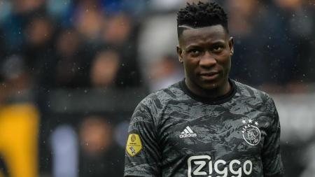 Kiper Ajax Amsterdam, Andre Onana, menjadi pemain yang diincar Manchester United untuk menggantikan David de Gea. - INDOSPORT