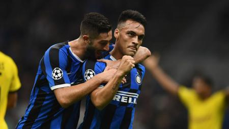 Penyerang Inter Milan, Lautaro Martinez, berhasil menyamai rekor Samuel Eto'o di Liga Champions. - INDOSPORT
