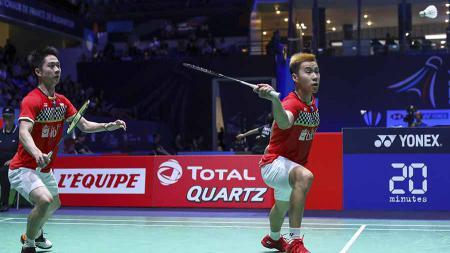 Kevin Sanjaya Sukamuljo menunjukan skill mematikan dengan back hand smash di final Fuzhou China Open 2019 - INDOSPORT