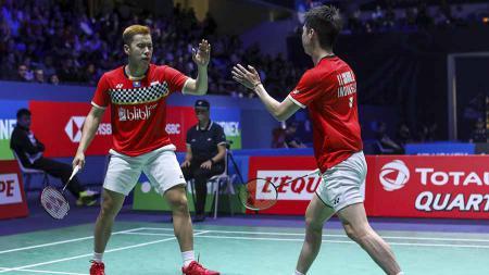 Kevin Sanjaya Sukamuljo/Marcus Fernaldi Gideon akan ditemani oleh beberapa pebulutangkis Indonesia di ajang BWF World Tour Finals 2019. - INDOSPORT
