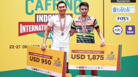 Ikhsan Leonardo Imanuel Rumbay (kanan) saat satu podium dengan Sony Dwi Kuncoro dalam ajang Caffino Indonesia International Challenge 2019. - INDOSPORT