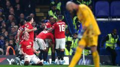 Indosport - Selebrasi pemain Manchester United usai Marcus Rashford mencetak gol kedua ke gawang Chelsea di ajang Carabao Cup.