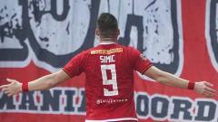 Indosport - Marko Simic berselebrasi usai mencetak gol ke gawang TIRA Persikabo.