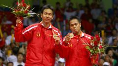 Indosport - Markis Kido/Hendra Setiawan saat mendapat medali emas Olimpiade Beijing 2008.