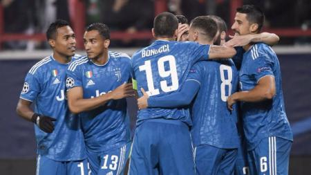 Aaron Ramsey selebrasi merayakan gol yang ia 'curi' dari Cristiano Ronaldo saat Juventus mengalahkan tuan rumah Lokomotiv Moskow di Liga Champions 2019-2020 - INDOSPORT