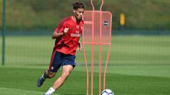 Indosport - William Saliba, bek muda Arsenal yang kini dipinjamkan ke Saint-Etienne