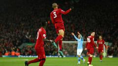 Indosport - Fabinho merayakan gol ke gawang Manchester City pada menit ke-6' pada laga Liga Inggris di Anfield.