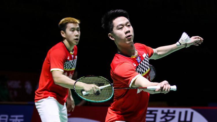Aksi Kevin Sanjaya bersama Marcus Gideon di final Fuzhou China Open 2019, Minggu (10/11/19). Copyright: Shi Tang/Getty Images