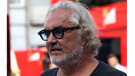 Mantan bos tim Renault di F1, Flavio Briatore. - INDOSPORT