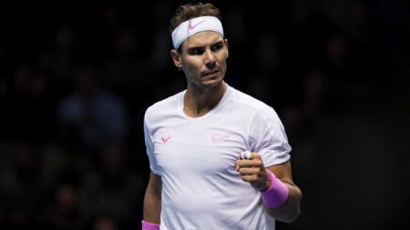 Rafael Nadal selebrasi usai mengalahkan Daniil Medvedev di Nitto ATP Finals 2019. - INDOSPORT