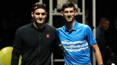 Indosport - Roger Federer dan Novak Djokovic di Nitto ATP Finals 2019.