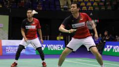 Indosport - Pasangan ganda putra Indonesia, Mohammad Ahsan/Hendra Setiawan, berhasil mengalahkan wakil Jepang, Hiroyuki Endo/Yuta Watanabe di final BWF World Tour Finals.
