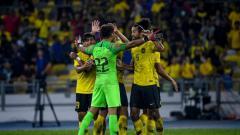Indosport - Selebrasi para pemain Timnas Malaysia usai mengalahkan Thailand di Kualfikasi Piala Dunia 2022.