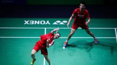 Indosport - Lu Kai(kanan) memutuskan mundur dari Timnas bulutangkis China.