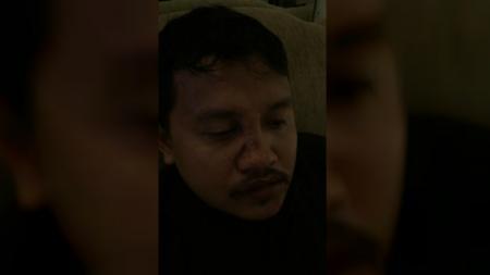 Salah satu suporter Timnas Indonesia yang dipukuli oknum fans Malaysia saat menyaksikan Kualifikasi Piala Dunia 2022. - INDOSPORT
