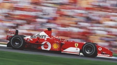 Michael Schumacher saat masih mengemudikan Ferrari F2002 saat masih aktif di Formula 1 (F1). - INDOSPORT