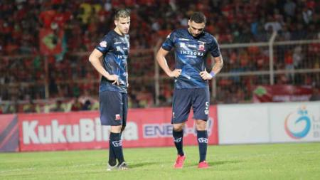 Jaimerson Xavier (kanan) dirumorkan tidak akan kembali ke Persija Jakarta usai dilepas Madura United beberapa hari yang lalu. - INDOSPORT