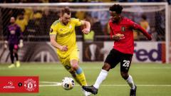 Indosport - Aksi pemain Manchester United Angel Gomes saat melawan Astana di lanjutan Liga Europa, Jumat (29/11/19).