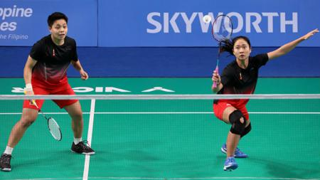 Ni Ketut Mahadewi Istarani/Apriyani Rahayu berhasil menyumbang poin pertama di partai kedua final bulutangkis beregu putri di SEA Games 2019. - INDOSPORT