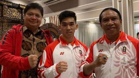 Atlet wushu Indonesia, Harris Horatius (tengah) berhasil menorehkan prestasi gemilang pada SEA Games 2019, Filipina. - INDOSPORT