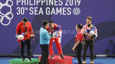Indonesia sukses merebut 4 medali emas, 1 perak, dan 5 perunggu dari cabor angkat besi dalam perhelatan SEA Games 2019 di Filipina. - INDOSPORT
