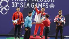 Indosport - Eko Yuli Irawan raih medali emas angkat besi kelas 61 kilogram putra di Nino Aquino Stadium, Manila, Senin (02/12/19).