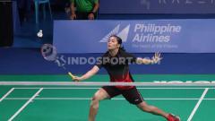 Indosport - Gregoria Mariska Tunjung vs Ratchanok Intanon di Muntinlipa Sport Complex, Manila, Selasa (03/12/19).
