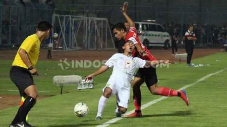 Kemenangan Persebaya atas Madura United pada Liga 1, Senin (02/12/19) di Stadion Gelora, Bangkalan, ada peran luar biasa dari gelandang mungil Rendi Irwan. - INDOSPORT