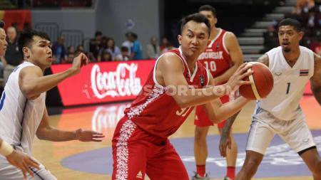 Kevin Yonas menyebut Timnas Basket Indonesia perlu sosok pemain naturalisasi berbadan besar bila ingin bersaing. - INDOSPORT
