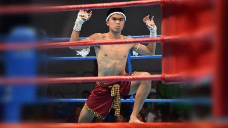 Kapten Persija Jakarta U-16, Muhammad Uchida Sudirman, meraih medali perunggu di cabang olahraga muaythai di ajang SEA Games 2019 Filipina. - INDOSPORT