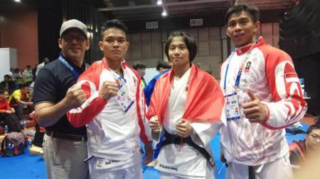 Tiga atlet judo Indonesia peraih medali SEA Games 2019: Budi Prasetyo, Ni Kadek Ani Pandini, Ikhsan Apriadi. - INDOSPORT