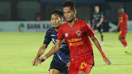 Madura United berhasil mencuri kemenangan telak di kandang Kalteng Putra pada Pekan ke-31 Liga 1 2019 dalam hasil pertandingan 1-4, Jumat (06/12/19). - INDOSPORT