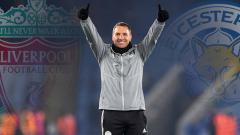Indosport - Perbandingan performa Brendan Rodgers saat melatih Leicester City dan Liverpool di Liga Inggris.