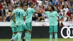 Indosport - Klub LaLiga Spanyol, Real Madrid, menggunakan jersey hijau mereka saat laga kandang kontra Espanyol di Santiago Bernabeu, Sabtu (07/12/19).