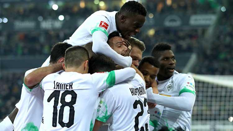 Selebrasi para pemain Borussia Monchengladbach saat memastikan kemenangan atas Bayern Munchen dalam pertandingan Bundesliga Jerman 2019-2020 Copyright: Lars Baron/GettyImages