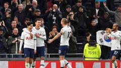 Indosport - Selebrasi pemain Tottenham Hotspur saat berhasil melibas Bournemouth dalam pertandingan Liga Inggris 2019-2020 pekan ke-16 di Tottenham Hotspur Stadium
